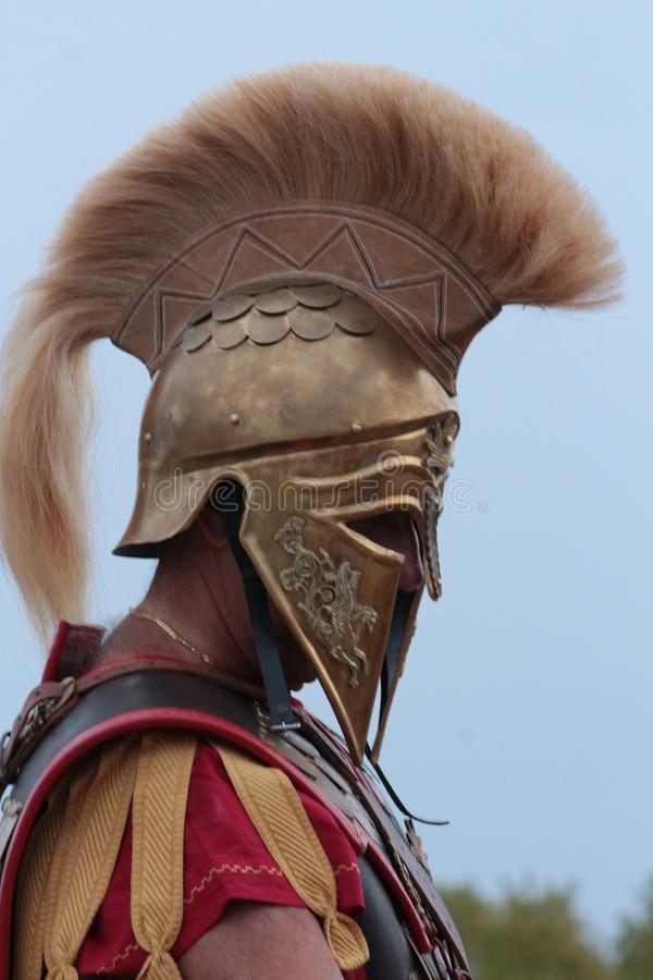 Old Greek soldier with helmet stock photos