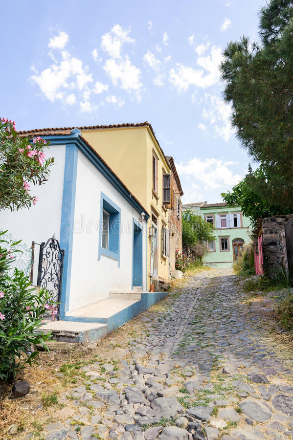 Download Old Greek Style Houses In A Narrow Street Of Cunda Alibey Island.  It Is