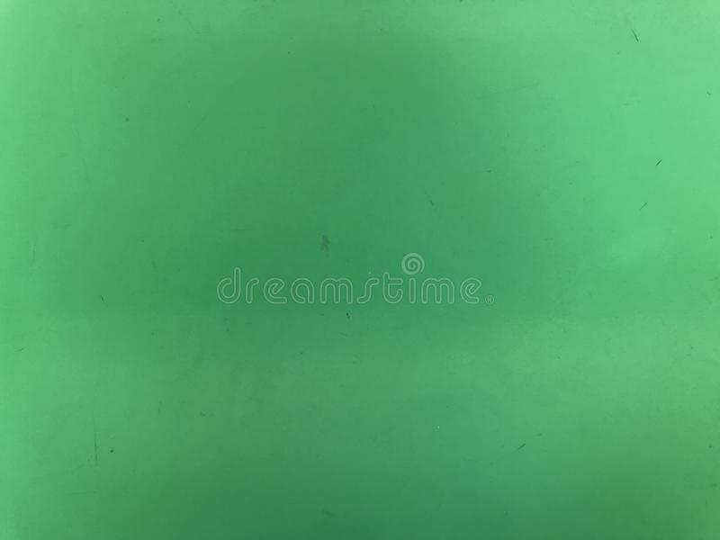 Old green colored aluminum sheet in day light. Full frame shot of old green colored aluminum sheet in day light, using for background stock image