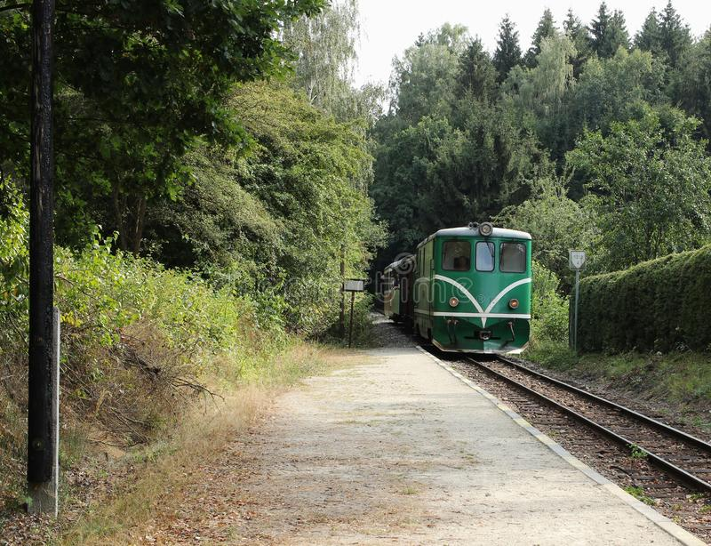 Old green diesel locomotive is approaching the station. Idyllic railway image. Summer train trip.  royalty free stock images