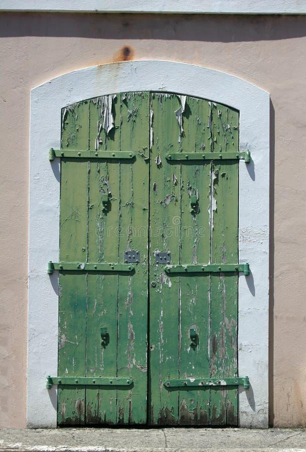Old green door. With paint peeling off stock image