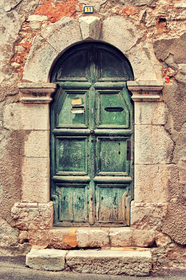 Old green door royalty free stock photography