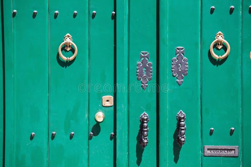 Old green door. Decorative old green door from Portugal stock photography