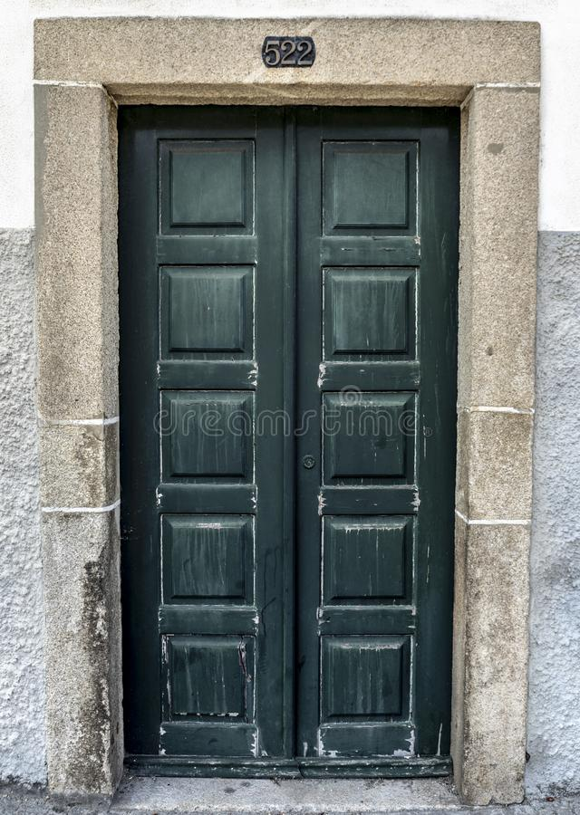 An Old Green Door With The Number 522. Old Green Door With The Number 522 royalty free stock photos