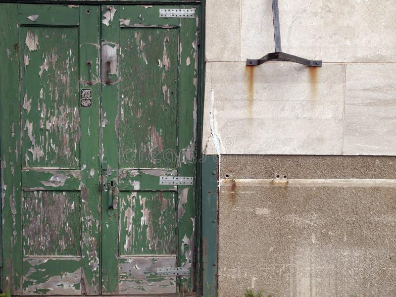 Old door with peeling paint. Old green door with peeling paint, old building stock images