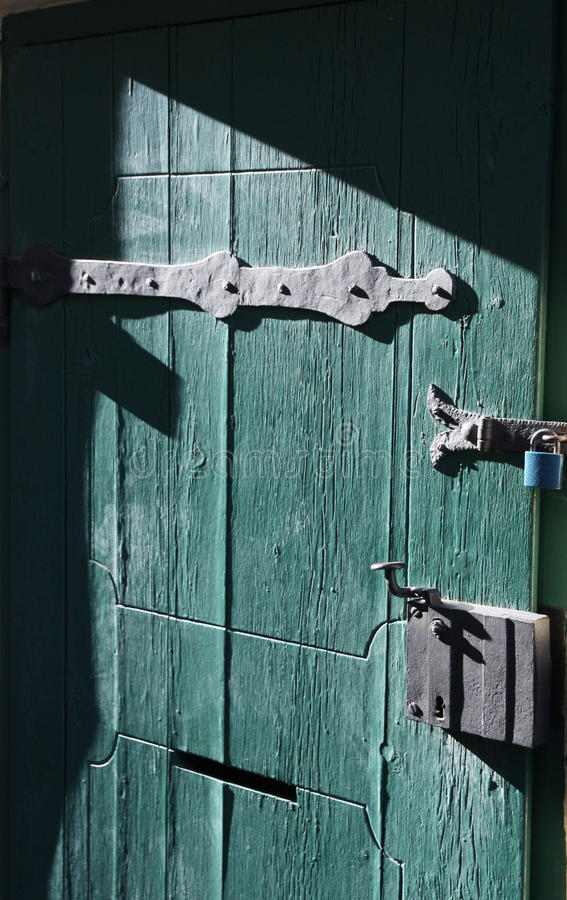 The old green door. On sunny day royalty free stock photos