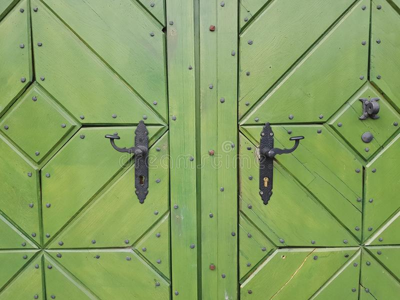 Old, green door to the castle. Wooden, history stock images