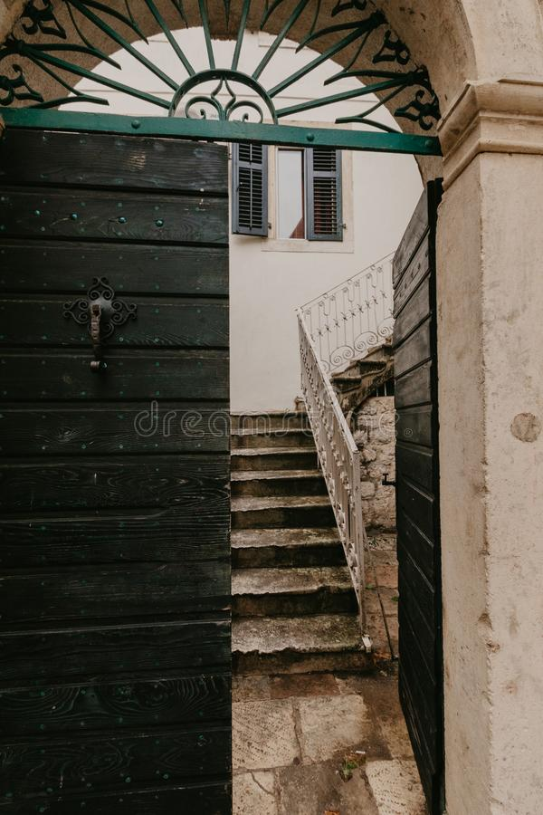 Old green doors that lead to the courtyard.  royalty free stock photography