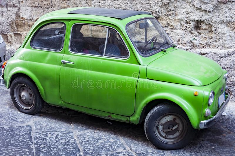 An old green Fiat 500, the famous Italian city car royalty free stock images