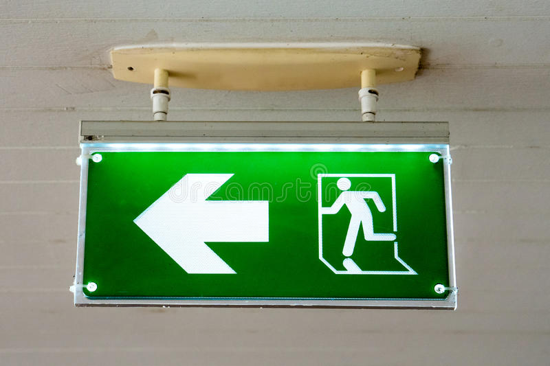 Old Green fire exit sign at hotel. Old Green fire exit sign at hotel royalty free stock photos
