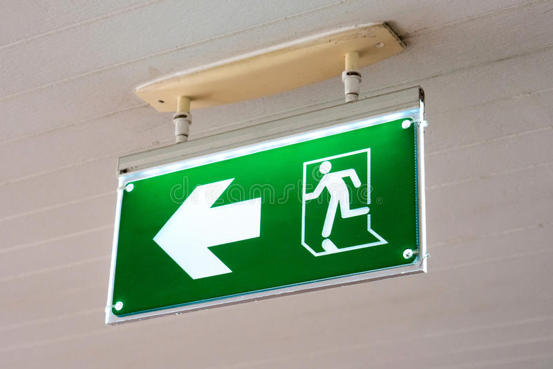 Old Green fire exit sign at hotel. Old Green fire exit sign at hotel stock image