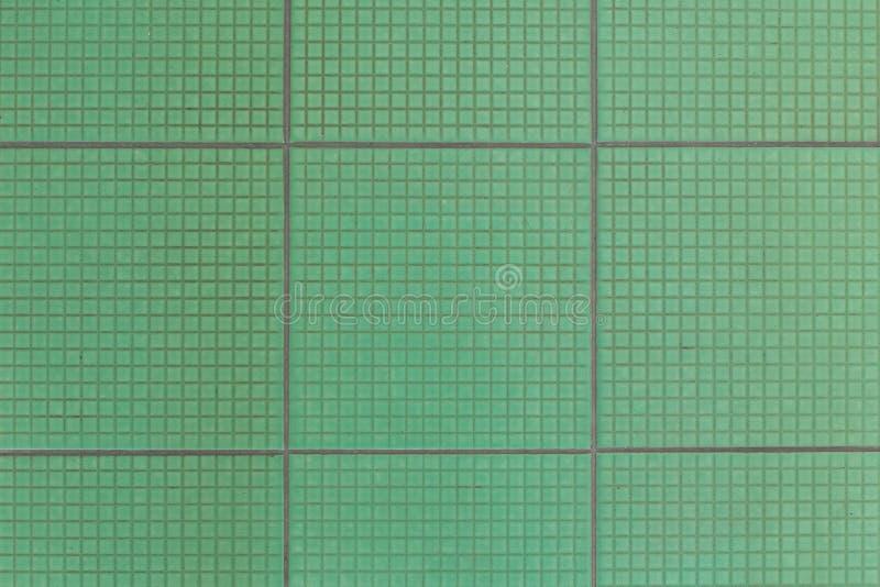 Old green floor tiles  texture background stock photo