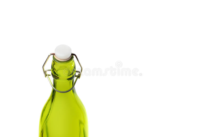 Old green glass bottle isolated on white background olive oil. White plastic cork and ply rusty latch in the bottle neck royalty free stock photography