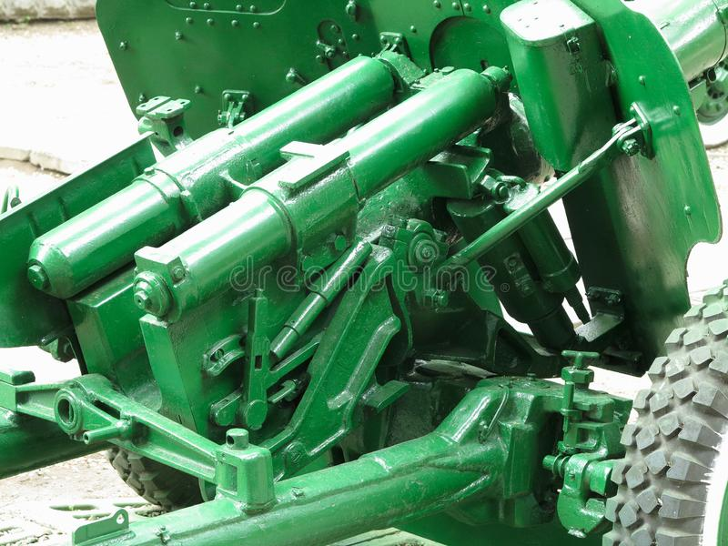 Old green russian artillery field cannon gun detail of mechanism royalty free stock photos