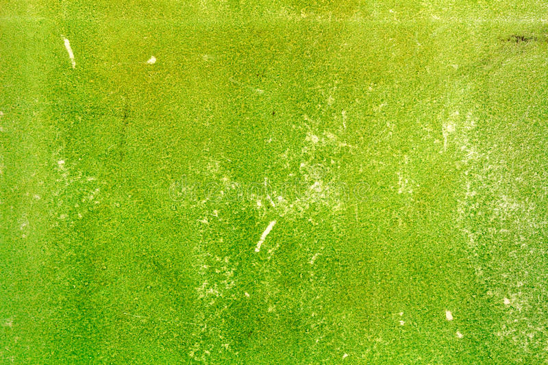 Old green shabby paper texture with scratches. Abstract background royalty free stock image