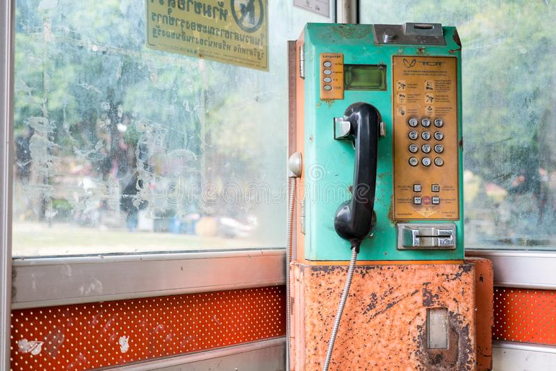 Old green telephone cabin royalty free stock images