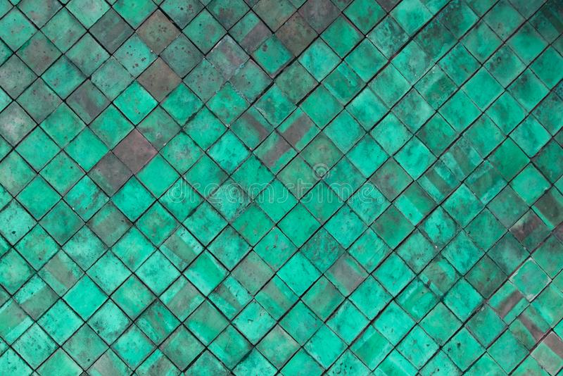 Old Green Terracotta tiles wall for texture and background royalty free stock photo