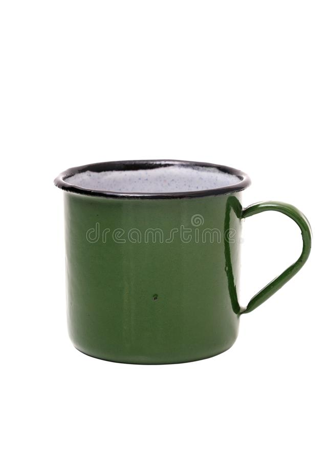 Old green tin Cup on white background. Green vintage metal mug isolated on white background.  royalty free stock image