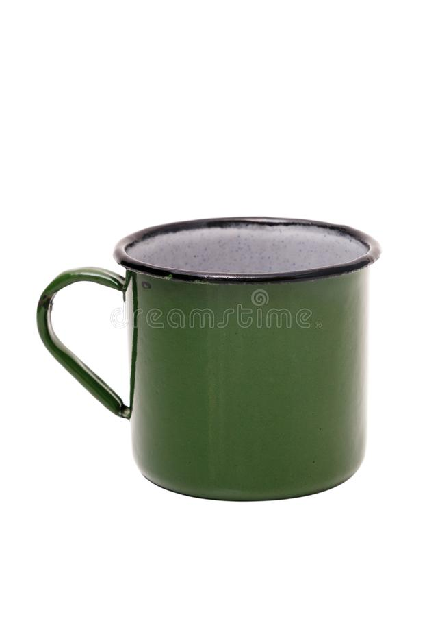 Old green tin Cup on white background. Green vintage metal mug isolated on white background.  royalty free stock images