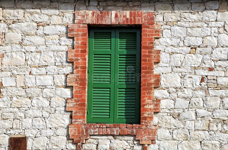 Old green window shutters of an mediterranean stone house royalty free stock photo