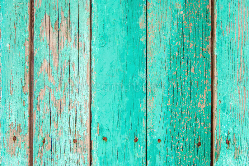 Old green wooden fence background. Close up royalty free stock photos