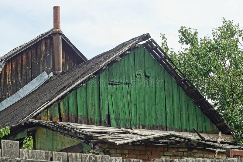 Old green wooden loft with the door of a rural house stock photo