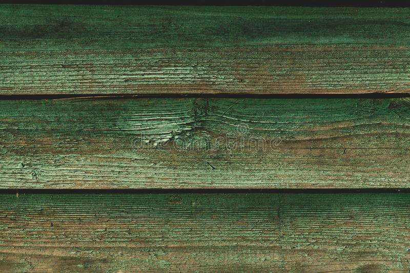 Old green wooden plank texture. wood background stock photography