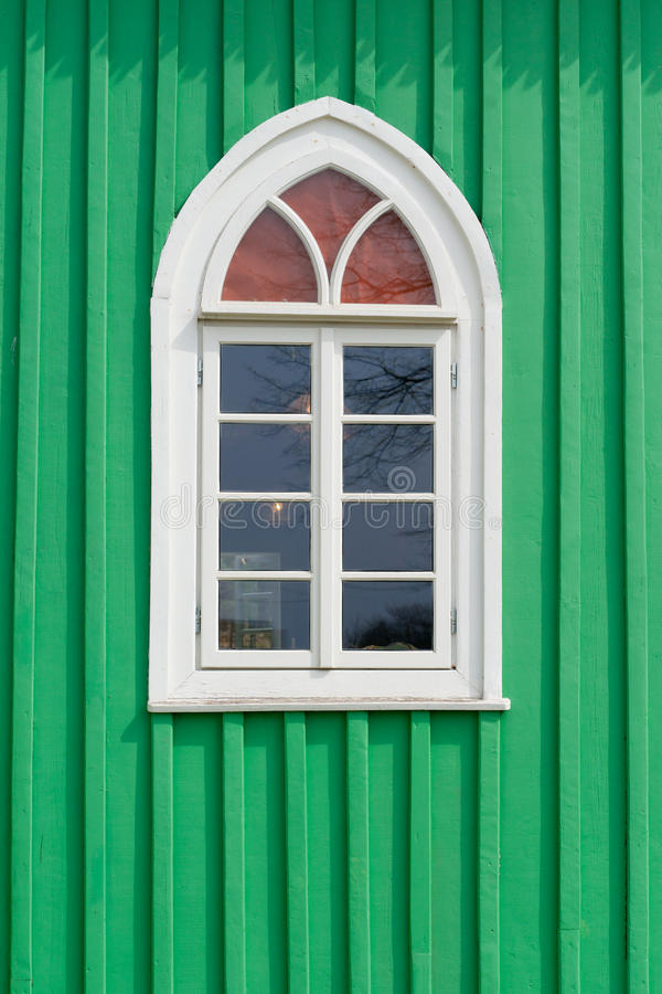 Old green wooden wall with window stock photos