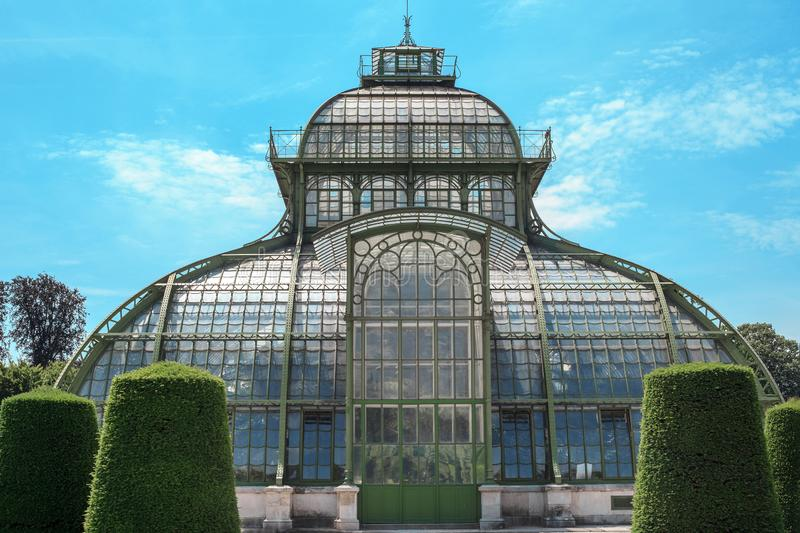 Old greenhouse in public park in Vienna, Austria. Old greenhouse in public park by blue sky in Vienna, Austria royalty free stock image