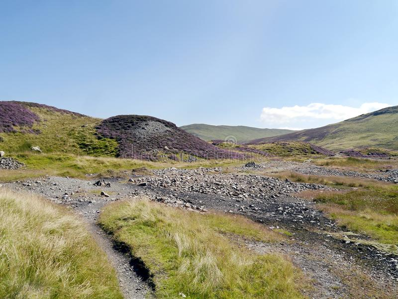The old Greenside mining area, Lake District. An area covered in heather and stone from a bygone age royalty free stock photo