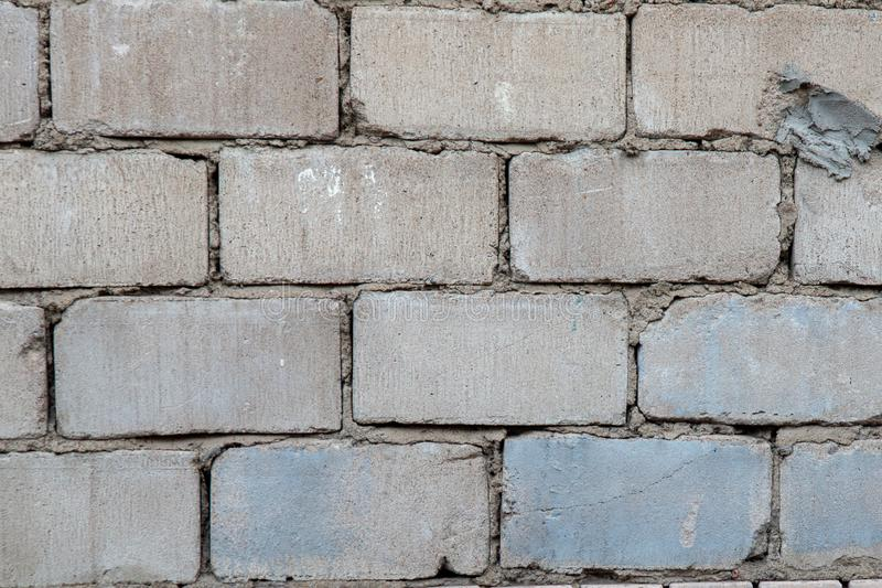 Old grey brick wall. Background texture royalty free stock images