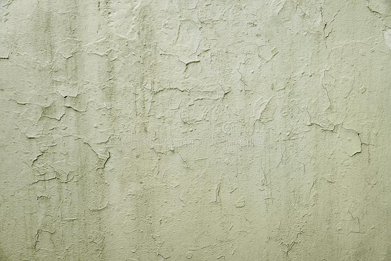 Old grey cracked painted wall background texture. Close up royalty free stock images