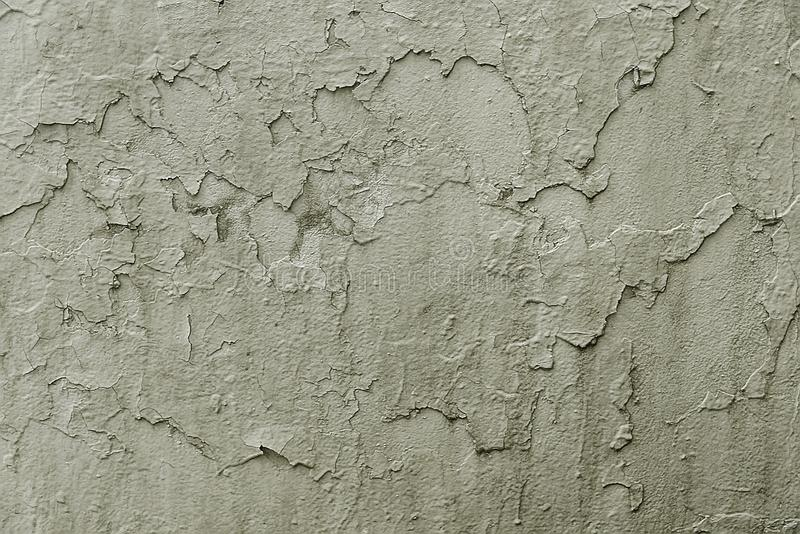 Old grey cracked painted wall background texture. Close up royalty free stock photography