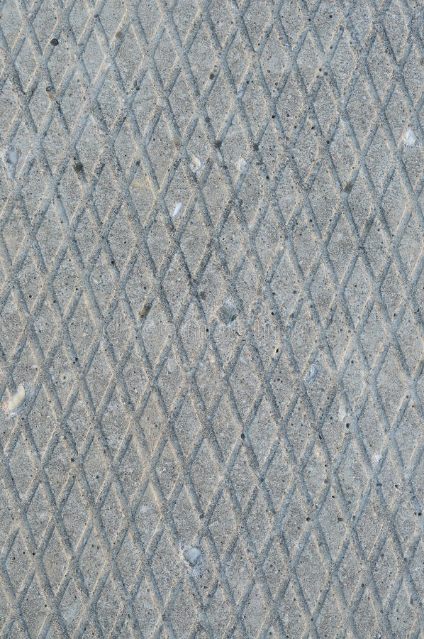 Old grey weathered concrete plate, rough grunge abstract cement tile texture diagonal groove pattern macro closeup, vertical royalty free stock image