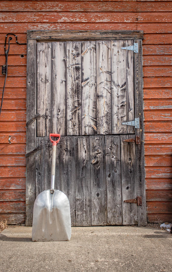 Download Old Grey Wood Barn Door With A Shovel Propped Against It. Stock Photo - & Old Grey Wood Barn Door With A Shovel Propped Against It. Stock ...