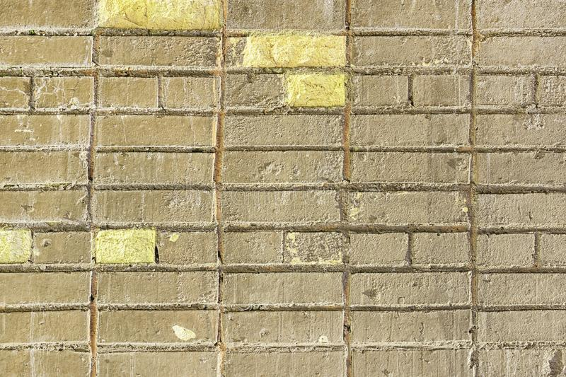 Old Grey Yellow Brick Wall Texture Background royalty free stock image