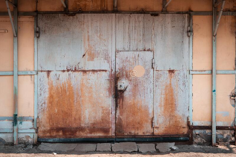 The old grim iron garage door.  stock photography