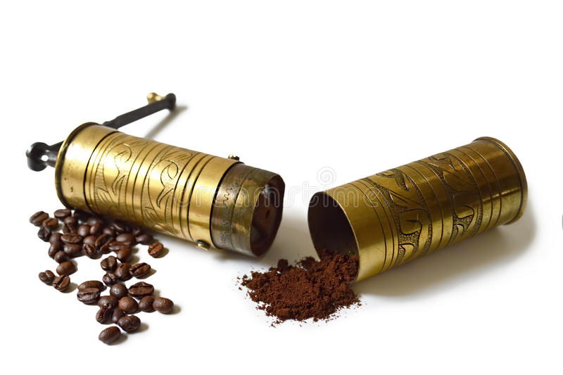 Old grinder, coffee beans and ground coffee royalty free stock image