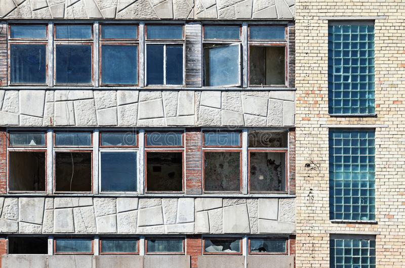 Old grunge abandoned building with broken windows. Destruction concept, vandalized urban decay royalty free stock photo