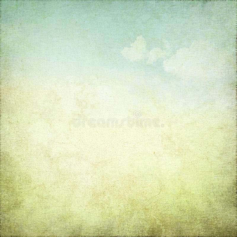 Old grunge background with delicate abstract canvas texture and blue sky view stock photo