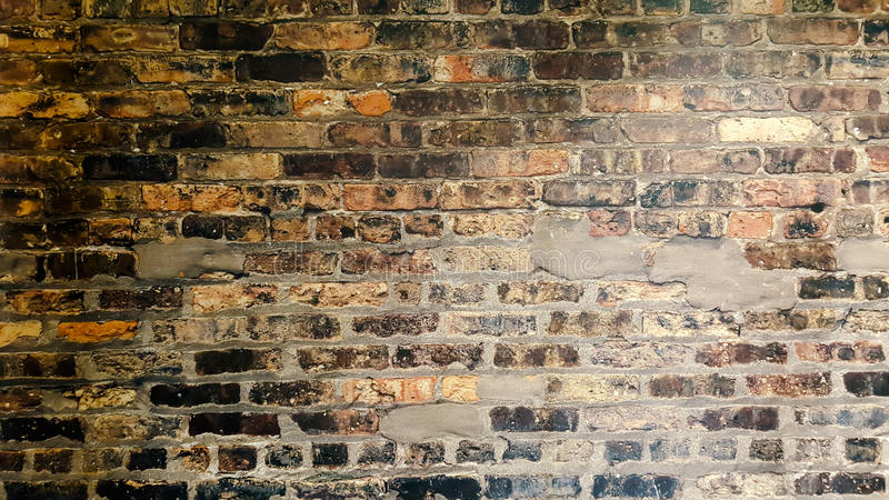 Old grunge brick wall background stock image