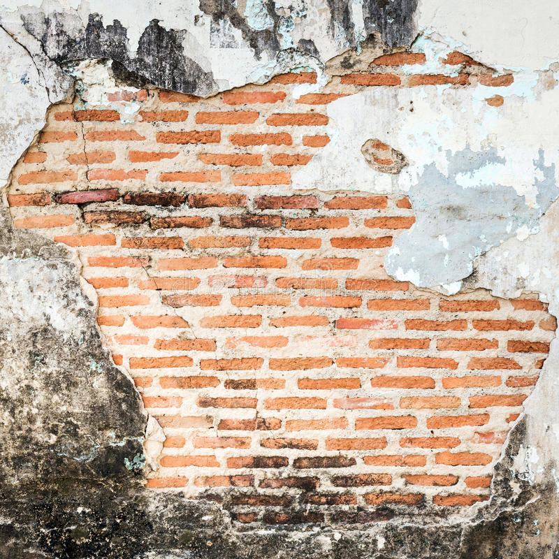 Old grunge brick wall fragment background. royalty free stock images
