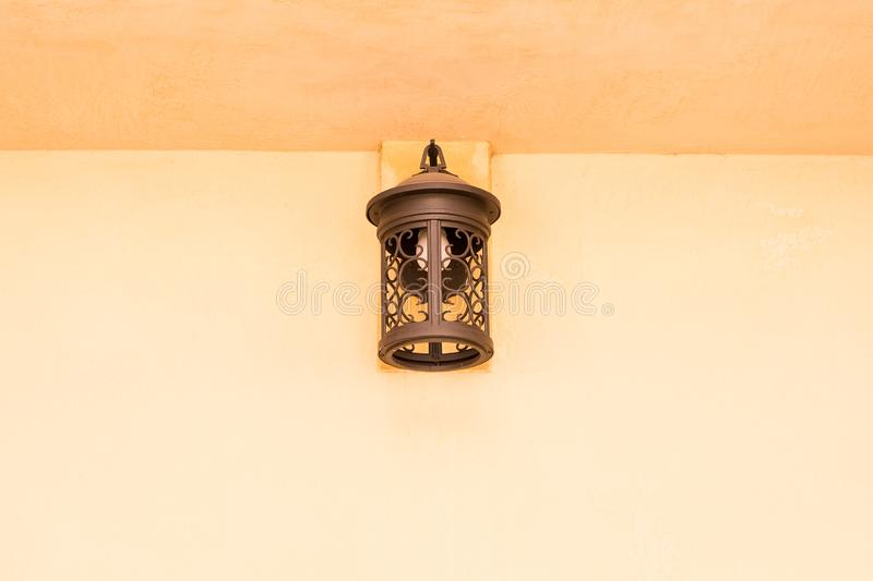 Old copper lamp on cement wall stock photo