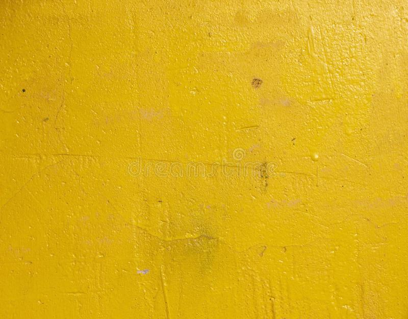 Old grunge cracked vintage light yellow concrete and cement mold texture wall or floor background stock image