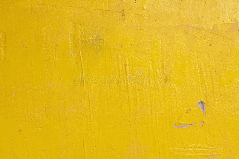 Old grunge cracked vintage light yellow concrete and cement mold texture wall or floor background with weathered paint royalty free stock photo