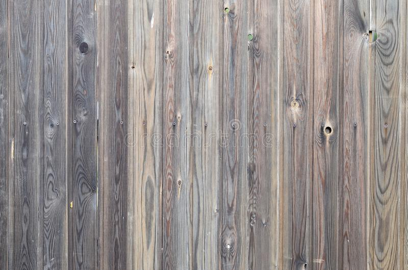 Old grunge dark brown wood panel pattern with beautiful abstract grain surface texture, vertical striped background or backdrop in. Architectural material stock photography