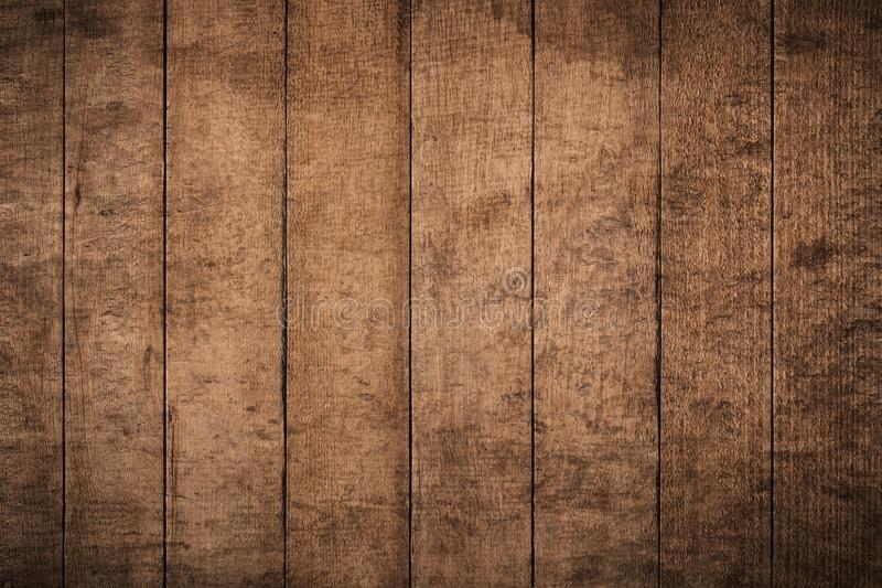 Old grunge dark textured wooden background,The surface of the old brown wood texture,top view brown wood paneling. Old grunge dark textured wooden background,The