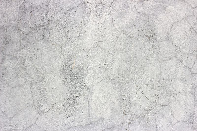 Old grunge dirty cracked vintage light gray concrete and cement mold texture wall or floor background with weathered paint. And scratches royalty free stock photo