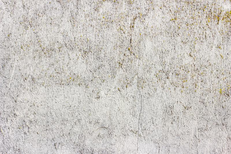 Old grunge dirty cracked vintage light gray concrete and cement mold texture wall or floor background. With weathered paint and scratches stock photo