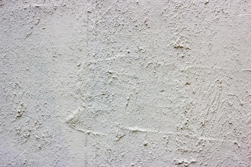 Old grunge dirty cracked vintage light gray concrete and cement mold texture wall or floor background with weathered paint. And scratches royalty free stock image